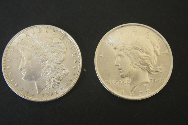 Limelight on History of Morgan and Peace Silver Dollars